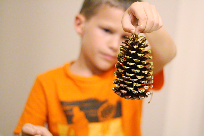 DIY Gold-Dipped Pinecone Place Card Holder | by Ashlee Proffitt