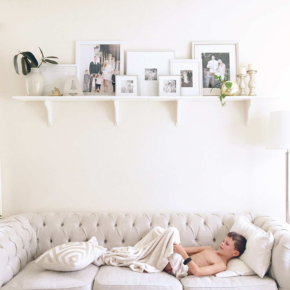 white-sofa-white-living-room-shelf-family-photos-ashlee-proffitt